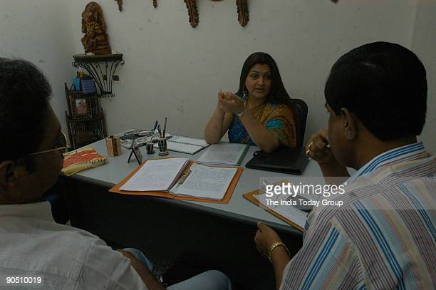 Khushboo actress discussing the script of her Mega serial Kalki with her crew at her office in Tnagar in Chennai Tamil Nadu India