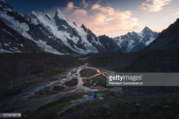 khuspang campsite at beautiful sunset in k2 base camp trekking route, karakoram mountain range in pakistan - k2 mountain stock pictures, royalty-free photos & images
