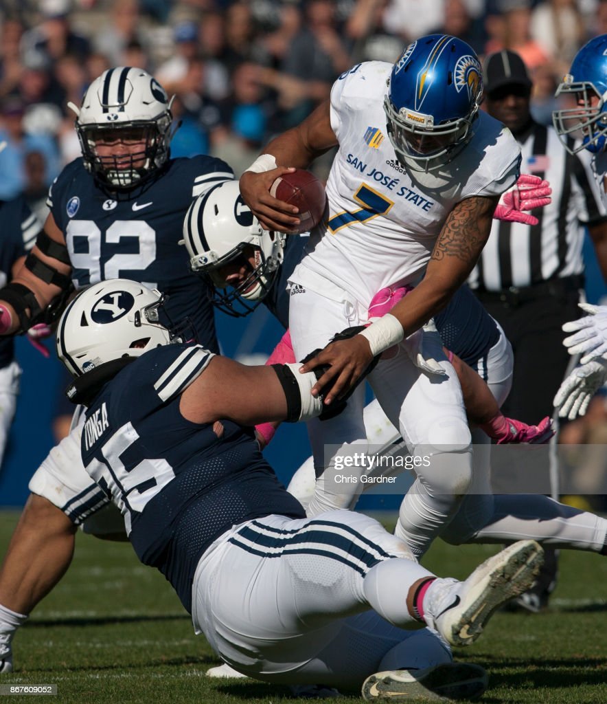Khyiris Tonga of the BYU Cougars grabs a hold of Montel ...
