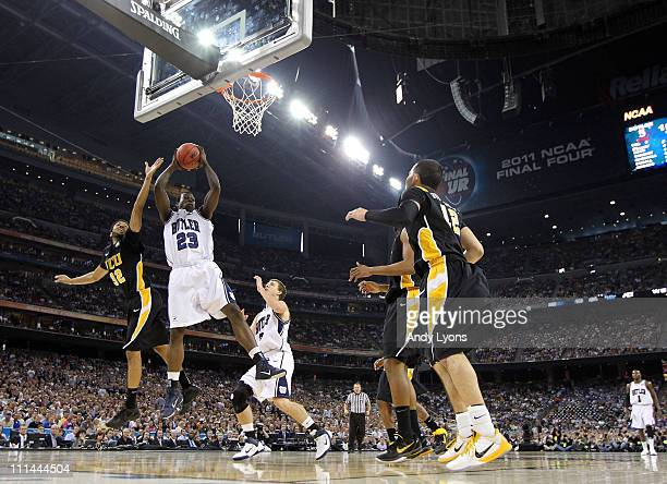 Khyle Marshall of the Butler Bulldogs goes up for the ball against Brandon Rozzell of the Virginia Commonwealth Rams during the National Semifinal...