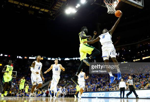 Khyri Thomas of the Creighton Bluejays drives on a fast break as Jo LualAcuil Jr #0 of the Baylor Bears defends during the National Collegiate...