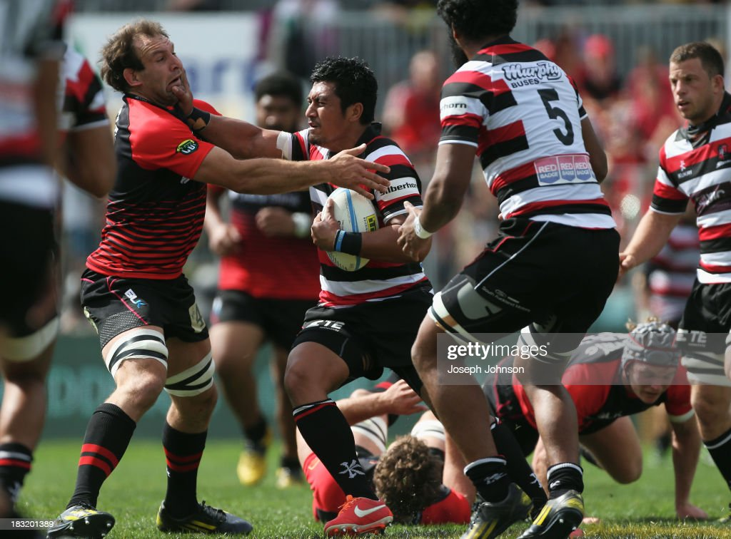 Ki Anufe of Counties Manukau runs with the ball in the tackle of George Whitelock of Canterbury during the round eight ITM Cup match between Cantebury and Counties Manukau at AMI Stadium on October 6, 2013 in Christchurch, New Zealand.