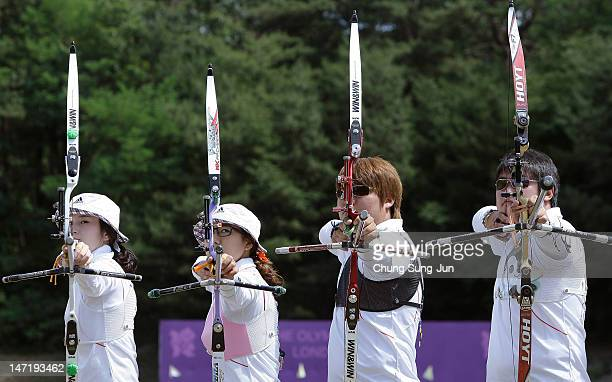 Ki Bo-Bae, Lee Sung-Jin, Kim Bub-Min and Oh Jin-Hyek of the South Korean Archery Team pose during the South Korea Olympic Team Media session at the...
