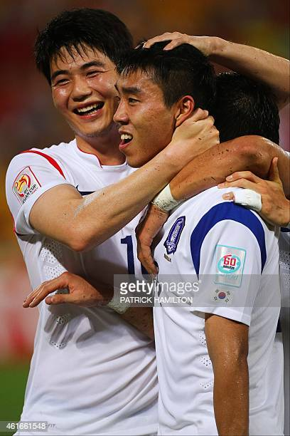 Ki Sung Yueng embraces Lee Jeonghyeop of South Korea as they celebrate a goal during the first round Asian Cup football match between South Korea and...