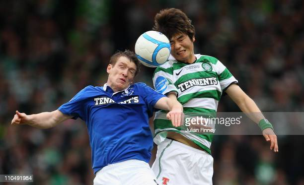 Ki Sung Yueng of Celtic goes for a header with Steven Davis of Rangers during the Cooperative Insurance Cup final between at Hampden Park on March 20...