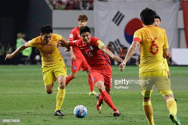 Ki Sung Yueng of South Korea and Zheng Zhi of China action during an 2018 Russia World Cup Asia Qualifiers South Korea V China match at World Cup...