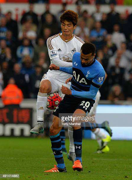 Ki Sung Yueng of Swansea City is tackled by Dele Alli of Tottenham Hotspur during the Barclays Premier League match between Swansea City and...