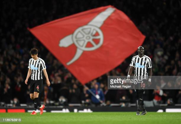 Ki SungYeung 1and Mohamed Diame of Newcastle United look dejected during the Premier League match between Arsenal FC and Newcastle United at Emirates...