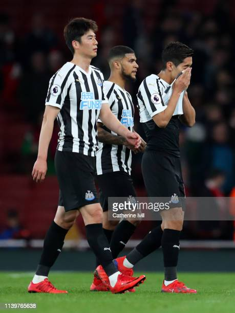 Ki SungYeung Deandre Yedlin and Yoshinori Muto of Newcastle United look dejected in defeat after the Premier League match between Arsenal FC and...
