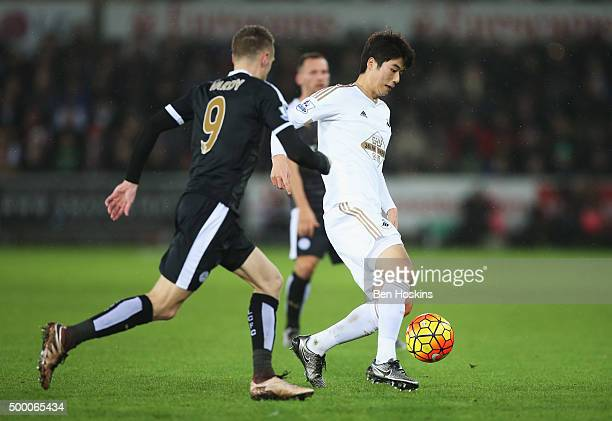 Ki SungYeung of Swansea City and Jamie Vardy of Leicester City compete for the ball during the Barclays Premier League match between Swansea City and...