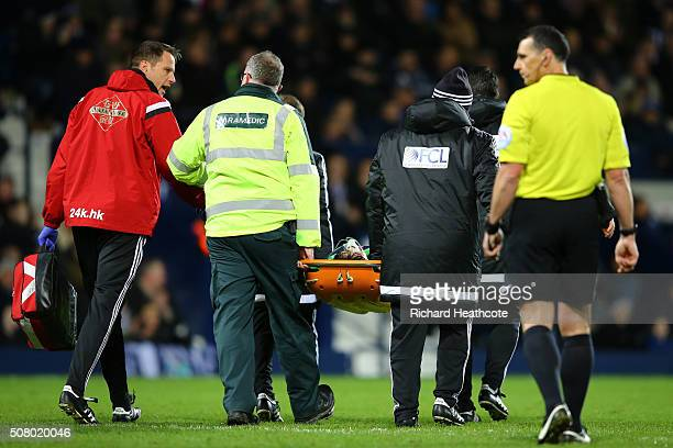 Ki SungYeung of Swansea City is stretched off the pitch after picking up injury during the Barclays Premier League match between West Bromwich Albion...