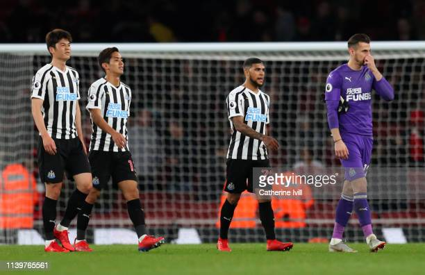 Ki SungYeung Yoshinori Muto Deandre Yedlin and Martin Dubravka of Newcastle United look dejected in defeat after the Premier League match between...