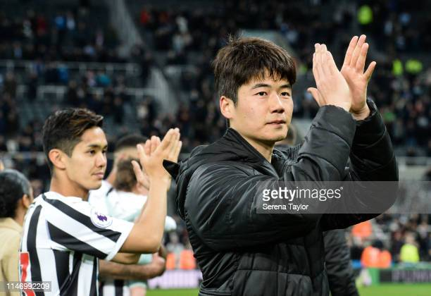 Ki SungYueng and Yoshinori Muto clap the fans after the Premier League match between Newcastle United and Liverpool FC at St James Park on May 04...