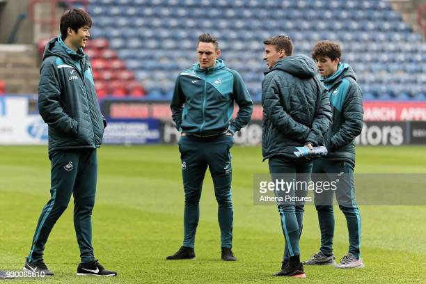 Ki SungYueng Connor Roberts Tom Carroll and Daniel James walk on the picth prior to the game during the Premier League match between Huddersfield...