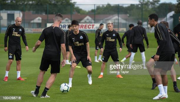 Ki Sungyueng is in the middle for a game of boxes during the Newcastle United Training Session at the Newcastle United Training Centre on July 23 in...