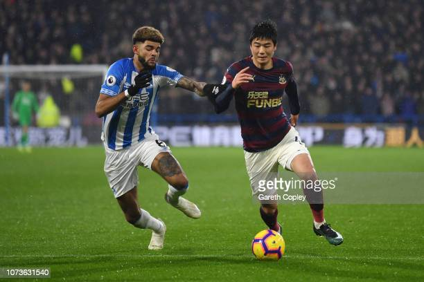 Ki SungYueng of Newcastle United battles for possession with Philip Billing of Huddersfield Town during the Premier League match between Huddersfield...