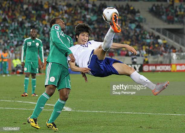 Ki SungYueng of South Korea attempts an overhead kick as Kalu Uche of Nigeria tries to get out of the way during the 2010 FIFA World Cup South Africa...