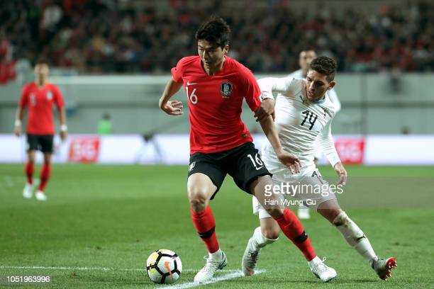 Ki SungYueng of South Korea competes for the ball with Lucas Torreira of Uruguay during the international friendly match between South Korea and...