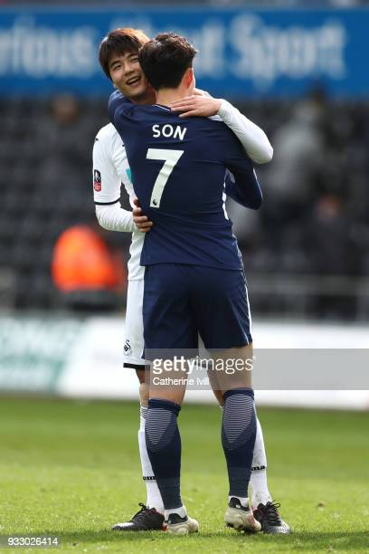 Ki SungYueng of Swansea City and HeungMin Son of Tottenham Hotspur embrace after The Emirates FA Cup Quarter Final match between Swansea City and...