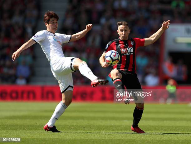 Ki SungYueng of Swansea City and Marc Pugh of AFC Bournemouth battle for the ball during the Premier League match between AFC Bournemouth and Swansea...