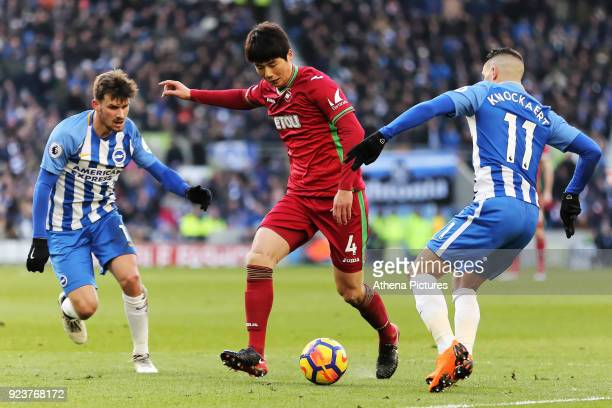 Ki SungYueng of Swansea City gets past Pascal Gross and Anthony Knockaert of Brighton during the Premier League match between Brighton and Hove...