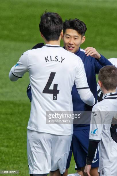Ki SungYueng of Swansea City greets Son HeungMin of Tottenham Hotspur during the Emirates FA Cup Quarter Final match between Swansea City and...