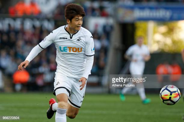 Ki SungYueng of Swansea City in action during the Premier League match between Swansea City and Southampton at The Liberty Stadium on May 08 2018 in...