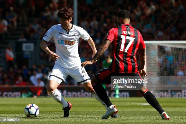 Ki Sungyueng of Swansea City is marked by Joshua King of Bournemouth during the Premier League match between AFC Bournemouth and Swansea City at...