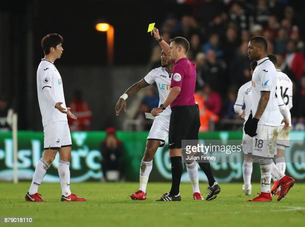 Ki SungYueng of Swansea City is shown a yellow card during the Premier League match between Swansea City and AFC Bournemouth at Liberty Stadium on...