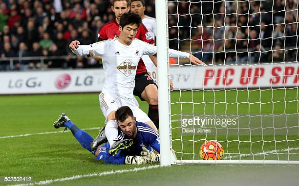 Ki SungYueng of Swansea City scores against West Bromwich Albion during the Barclay's Premier League match between Swansea City v West Bromwich...