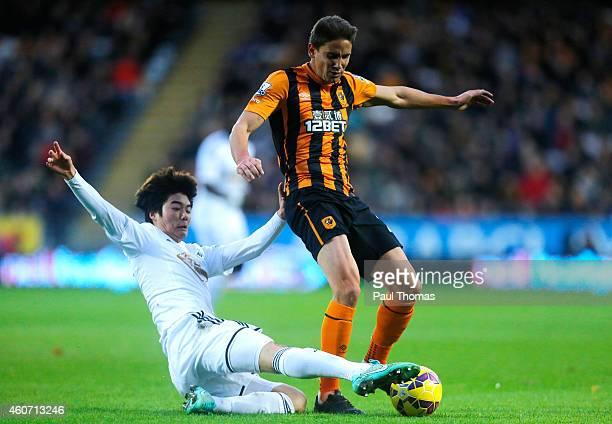 Ki SungYueng of Swansea City tackles Gaston Ramirez of Hull City during the Barclays Premier League match between Hull City and Swansea City at KC...