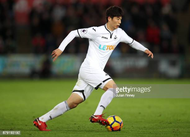 Ki SungYueng of Swansea in action during the Premier League match between Swansea City and AFC Bournemouth at Liberty Stadium on November 25 2017 in...