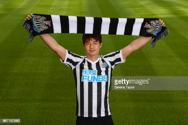 Ki Sungyueng poses for photographs after signing for Newcastle United at StJames' Park on June 29 in Newcastle upon Tyne England