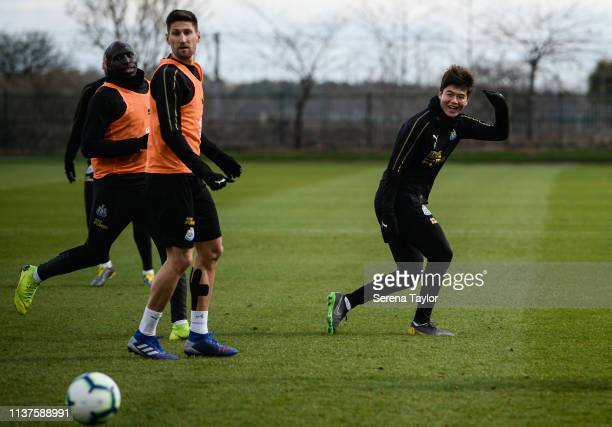 Ki SungYueng smiles as he passes the ball during the Newcastle United Training Session at the Newcastle United Training Centre on March 22 2019 in...