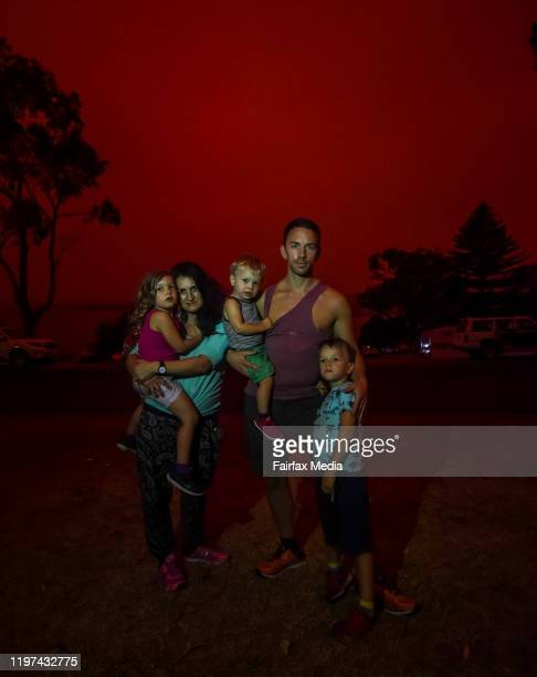 Kia and Deniz Kirschbaum with kids Samira Kian and Nuri as day turns to a blood red sky in Mallacoota with the South Westerly change sparking up fire...