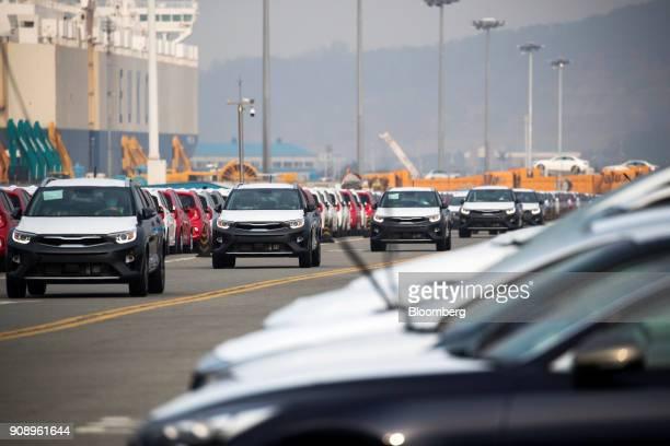 Kia Motors Corp vehicles bound for export are driven at the port of Pyeongtaek in Pyeongtaek South Korea on Monday Jan 22 2018 Kia Motors is...