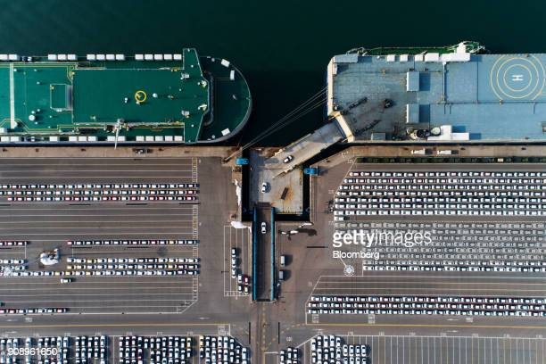 Kia Motors Corp vehicles bound for export are driven on to a Eukor Car Carriers Inc rollon/rolloff vehicles carrier cargo ship right in this aerial...