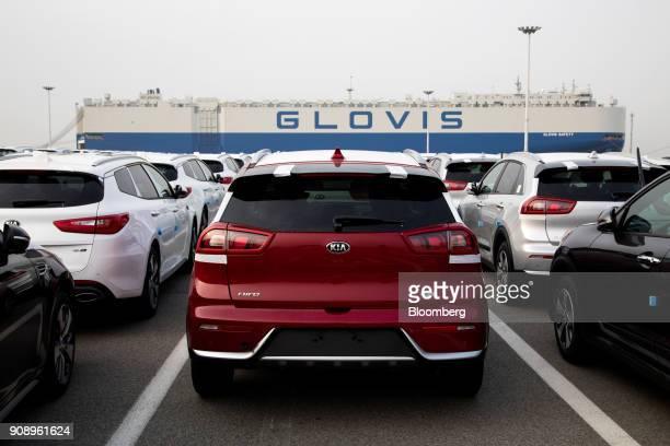 Kia Motors Corp vehicles bound for export await shipment as the Hyundai Glovis Co Glovis Safety rollon/rolloff vehicles carrier cargo ship sits...