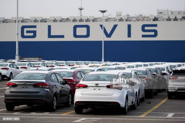 Kia Motors Corp vehicles bound for export await shipment as the Hyundai Glovis Co Glovis Safety rollon/rolloff vehicles carrier cargo ship at the...