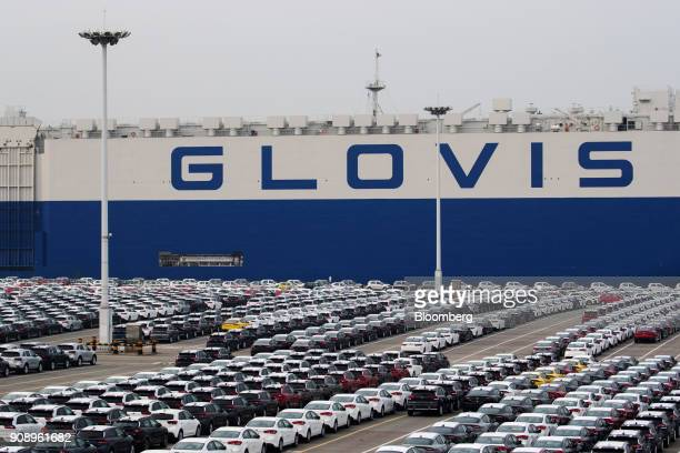 Kia Motors Corp vehicles bound for export await shipment as the Hyundai Glovis Co rollon/rolloff vehicles carrier cargo ship sits docked at the port...