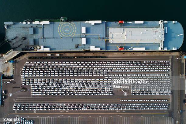 Kia Motors Corp vehicles bound for export await shipment as the Eukor Car Carriers Inc rollon/rolloff vehicles carrier cargo ship sits docked in this...