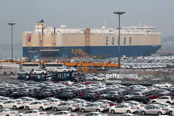 Kia Motors Corp vehicles bound for export await shipment as the Eukor Car Carriers Inc rollon/rolloff vehicles carrier cargo ship sits docked at the...