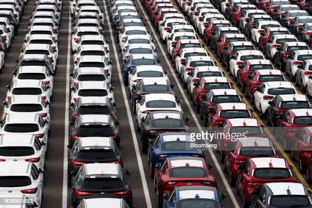 Kia Motors Corp vehicles bound for export await shipment at the port of Pyeongtaek in Pyeongtaek South Korea on Monday Jan 22 2018 Kia Motors is...
