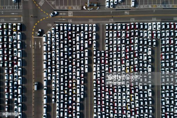 Kia Motors Corp vehicles bound for export await shipment in this aerial photograph taken above the port of Pyeongtaek in Pyeongtaek South Korea on...