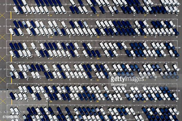 Kia Motors Corp vehicles sit parked in this aerial photograph taken above the company's delivery center in Gwangju South Korea on Friday July 8 2016...