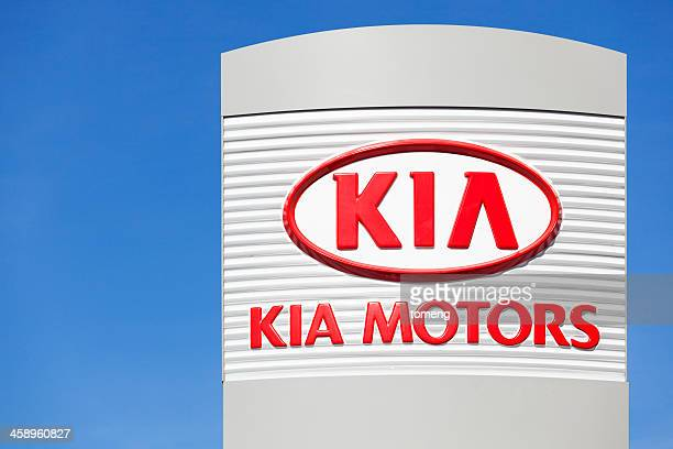 kia motors sign above dealership - kia stock pictures, royalty-free photos & images