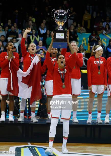 Kia Nurse of Canada lifts the trophy to celebrate after winning the match between Argentina and Canada as part of the FIBA Women's AmeriCup Final at...