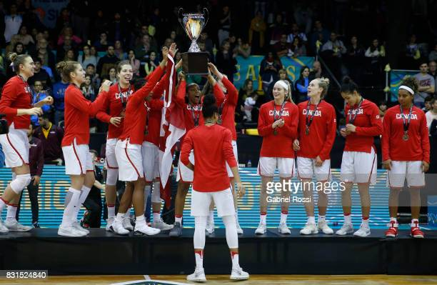 Kia Nurse of Canada lifts the trophy with her teammates to celebrate after winning the match between Argentina and Canada as part of the FIBA Women's...
