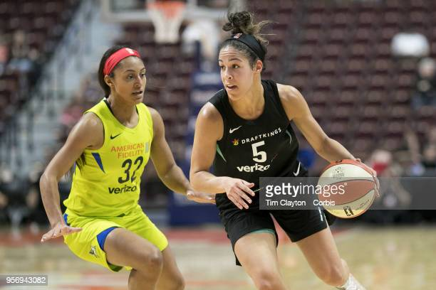 Kia Nurse of the New York Liberty defended by Loryn Goodwin of the Dallas Wings during the Dallas Wings Vs New York Liberty WNBA pre season game at...