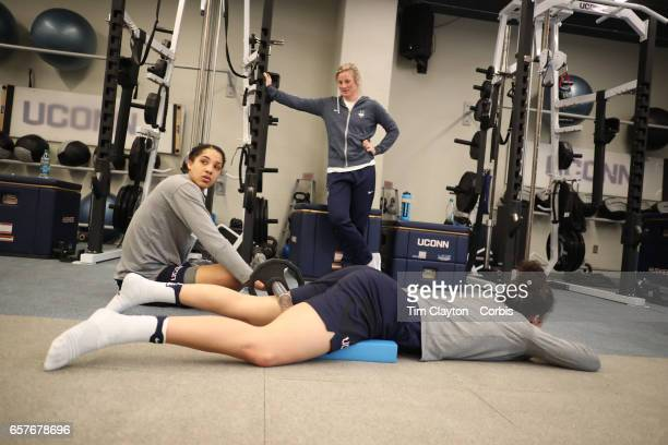 Kia Nurse with Gabby Williams during team warm down and stretching under the supervision of strength coach Amanda Kimball during the The UConn...